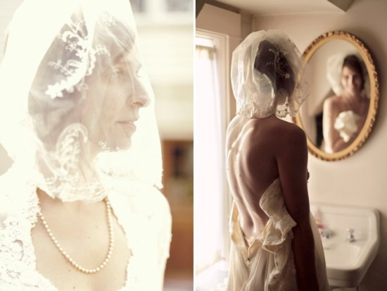 Vintage chic bride wears ivory sleeved lace wedding dress and traditional bridal veil
