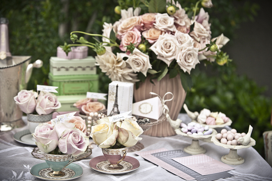 Romantic pastel DIY wedding reception centerpieces arranged in vintage teacups