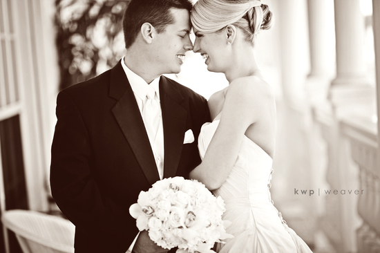 Stunning bride and groom kiss after saying I Do
