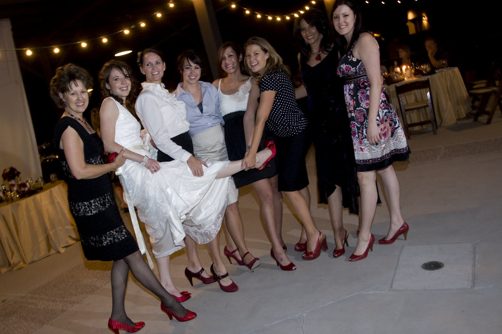 Charity-wedding-ideas-red-bridal-heels-bridesmaids-shoes-bridal-party-white-wedding-dress.full
