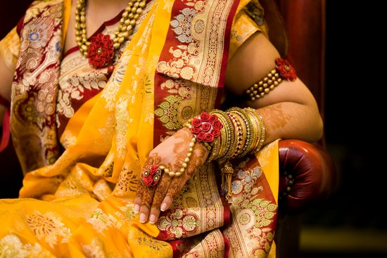New York bride wears traditional wedding sari and bridal henna