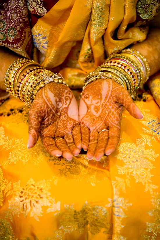 Gorgeous Indian bride opens palms, shows off bridal henna and wedding jewelry
