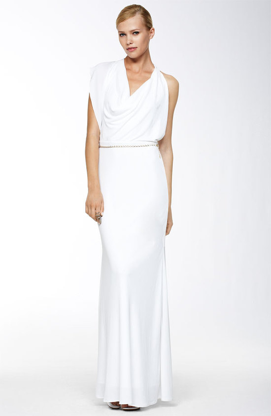 White column wedding dress with asymmetrical neckline and bridal belt