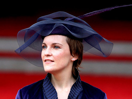 Chic navy blue wide brimmed hat at royal wedding