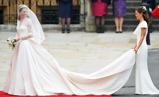 Kate Middleton's MOH Pippa (her sister) holds train on Sarah Burton for Alexander McQueen wedding dr