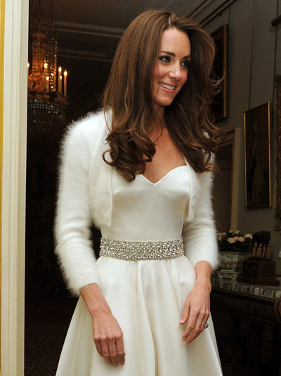 Kate Middleton changes into wedding reception dress, also by Sarah Burton