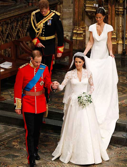 Prince William holds Kate Middleton's hand as they exit the Westminster Abbey