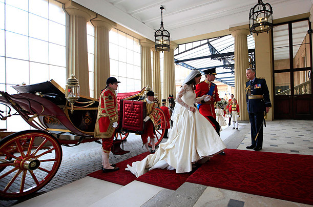 Prince William and Kate Middleton exit their royal wedding carriage