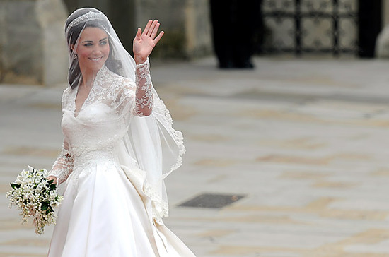 Kate Middleton waves to crowd, wears classic ivory gown by Sarah Burton