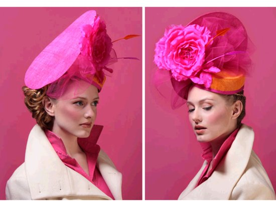 Chic hot pink statement making wedding guest hat