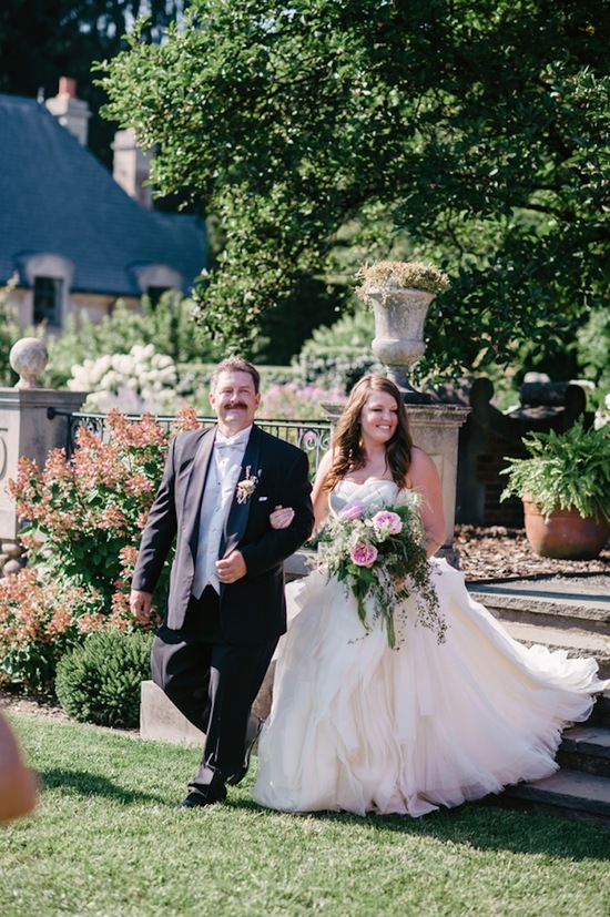 Bride with father walk down the aisle