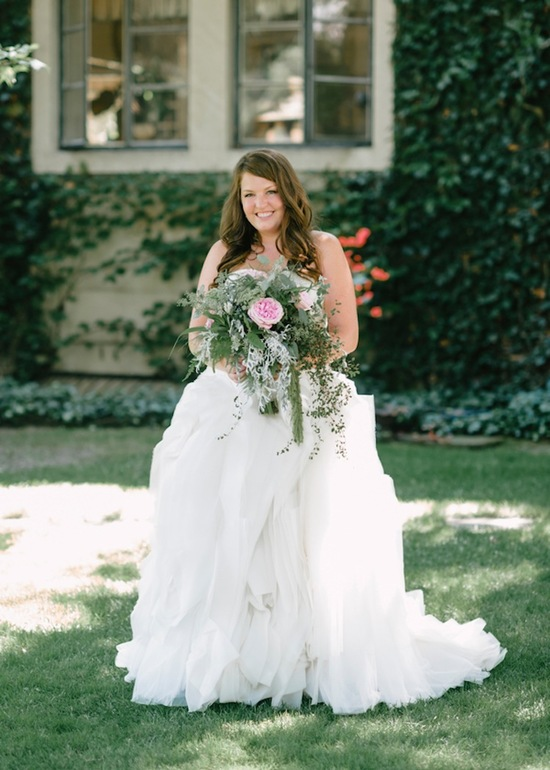 Real bride in outdoor courtyard setting