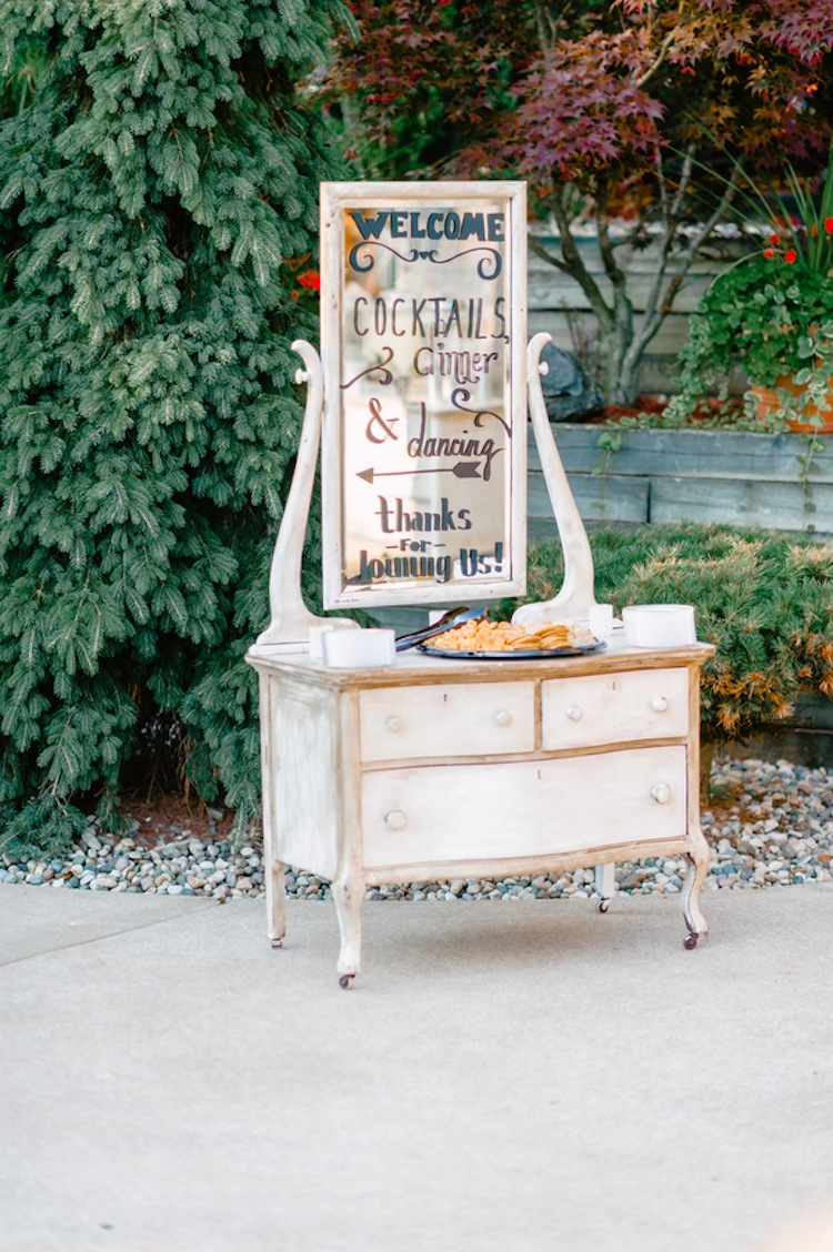 Welcome table on an antique dresser with appetizers
