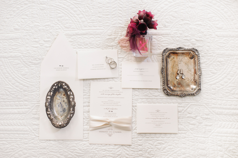 White classic wedding invitations and bridal jewelry