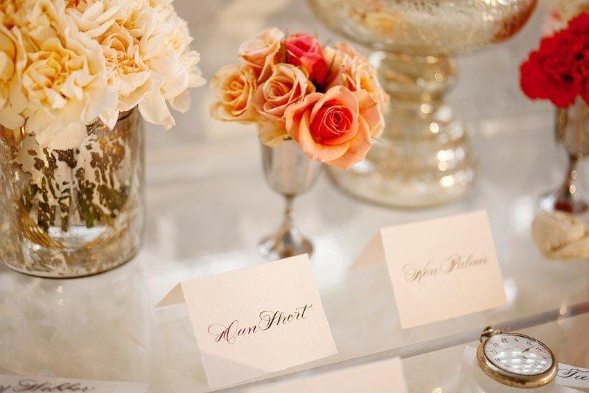 Bhldn-inspired-wedding-reception-decor-orange-flowers-escort-cards.full