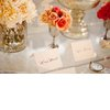 Bhldn-inspired-wedding-reception-decor-orange-flowers-escort-cards.square