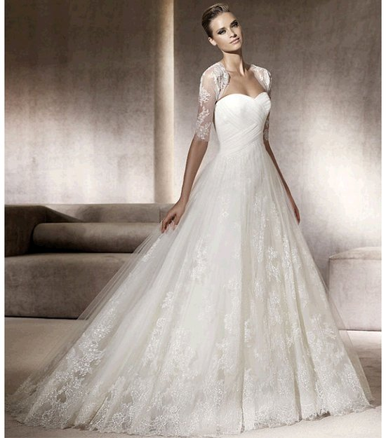 Romantic full a-line Pronovias wedding dress with lace bolero