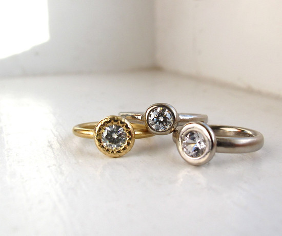 photo of 18 Karat Gold and Moissanite Raw Circle Solitaire Engagement Ring