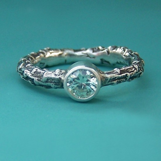 Eco-chic organic engagement ring with textured band and round diamond