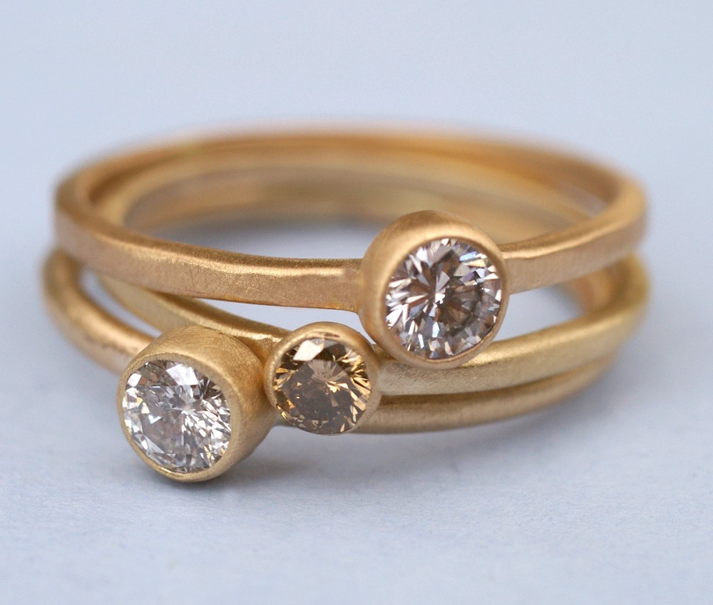 Chic recycled gold wedding bands and diamond engagement ring
