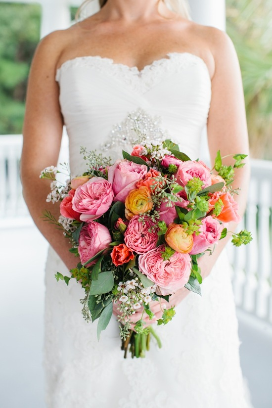 Big bridal bouquet with pink peonies yellow ranunculus and baby s breath