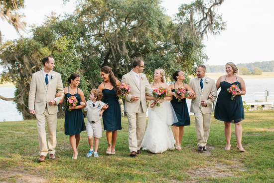 Bridal party in tan suits and blue bridesmaids dresses