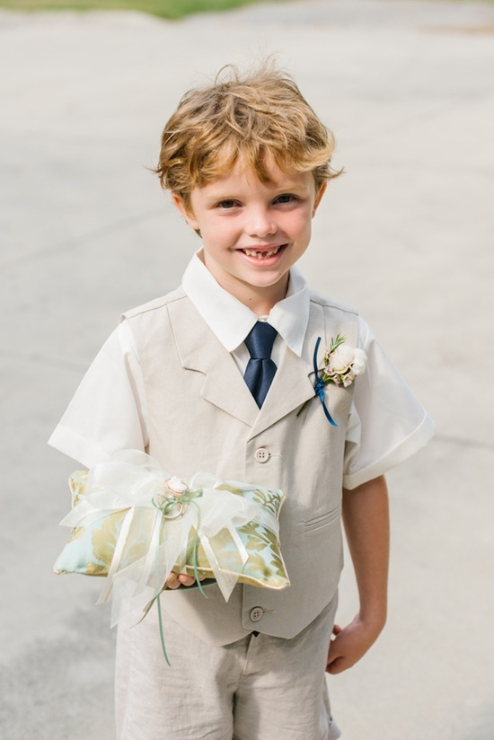Ring bearer with a grey suit