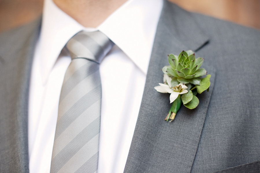 Dapper-groom-grey-suit-formalwear-eco-friendly-boutoinniere-succulents-wedding-flowers.full