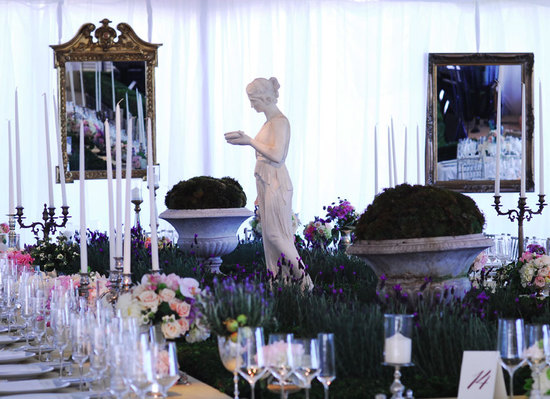 Romantic tented garden wedding reception with antique touches