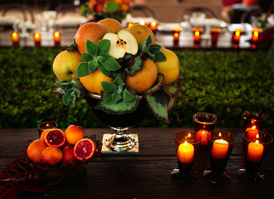 Unique wedding reception table centerpiece featuring citrus fruit