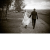 Romantic-wedding-photo-_bride-groom-hold-hands-outdoors.square