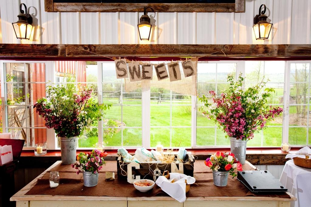 Rustic-wedding-reception-real-weddings-dessert-table-wedding-flower-centerpieces.full