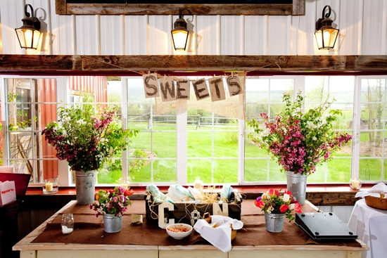 Adorable Sweets table at country chic wedding reception in Jackson, Wyoming