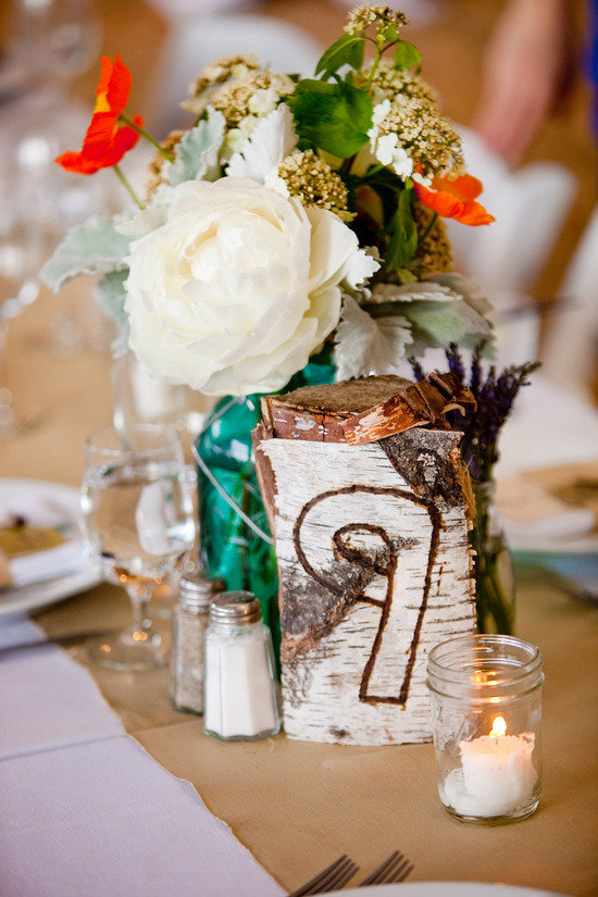 Rustic chic wedding reception centerpieces with colorful flowers
