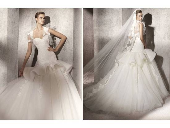 2012 Pronovias wedding dress with romantic bustle and tulle skirt