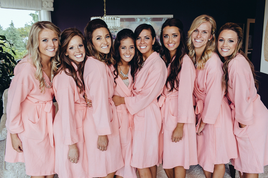 Bridesmaids prepping in robes