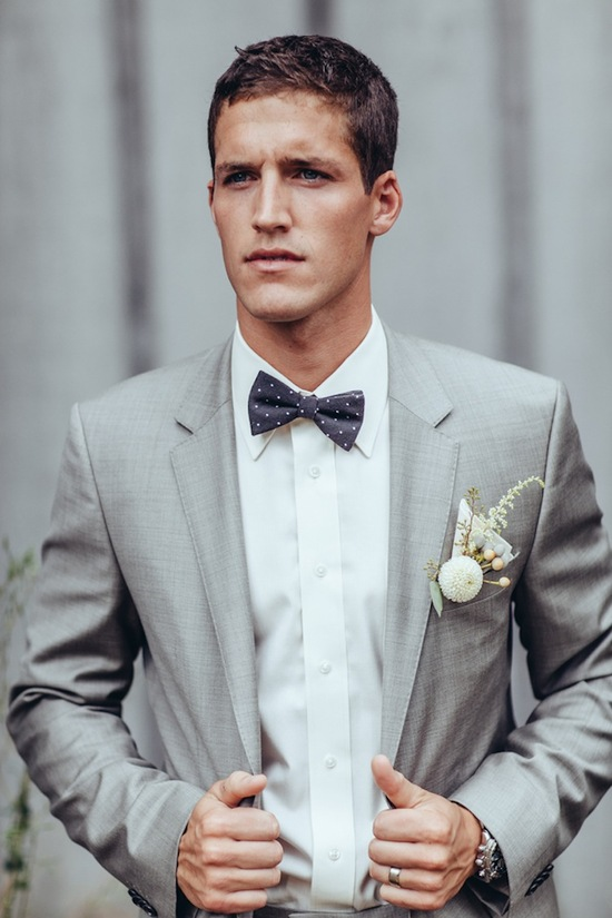 Dapper real groom in suit