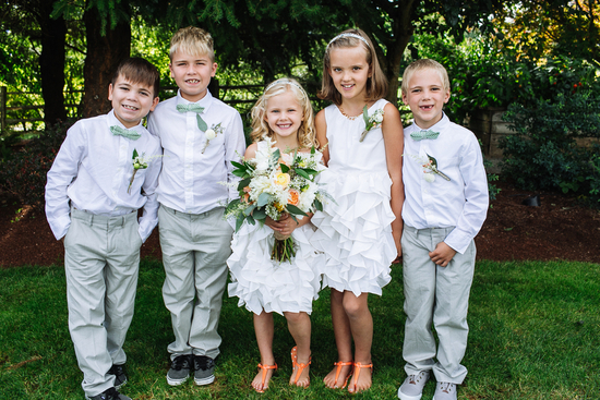 Flower girls and ring bearers pose for picture