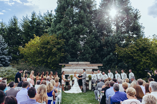 Outdoor real wedding ceremony with wood background
