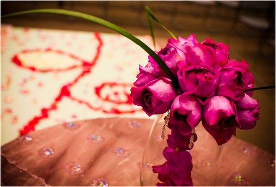 Gorgeous deep pink DIY bridal bouquet and rose petal ceremony aisle