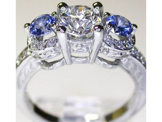 Sapphire-diamond-engagement-ring-3-stone-2011-wedding-rings.medium_large