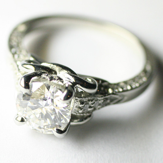 Round diamond engagement ring with pave setting