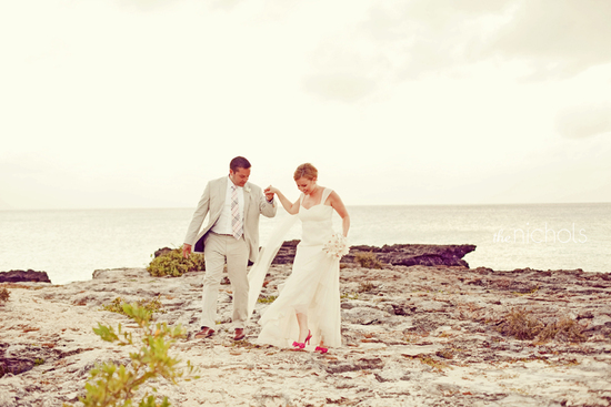 Beach bride and groom take romantic photos near the ocean