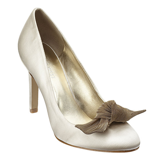 Ivory satin closed-toe bridal pumps with contrasting textured bow