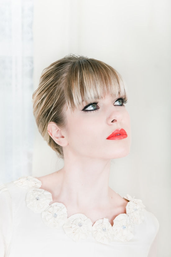 Modern wedding day look- bright, bold red/orange lips, heavy bangs