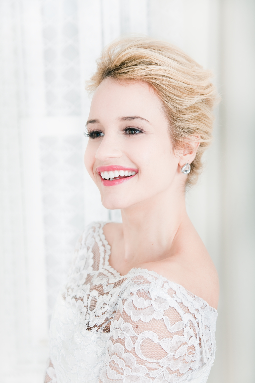 swept back bridal updo with natural makeup and off-the-shoulder ...