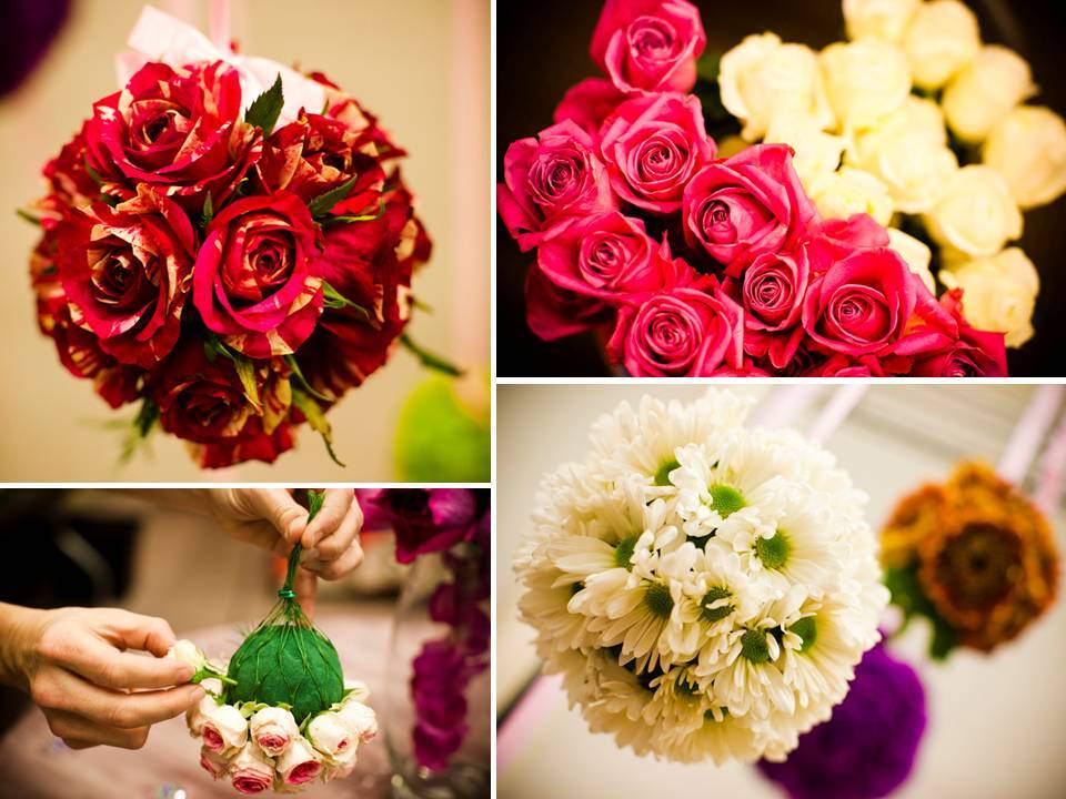 Red, pink and ivory roses and colorful Gerbera daisies arranged in floral pomander balls