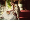 Beach-bride-and-groom-white-wedding-dress-khaki-suit-destination-wedding.square