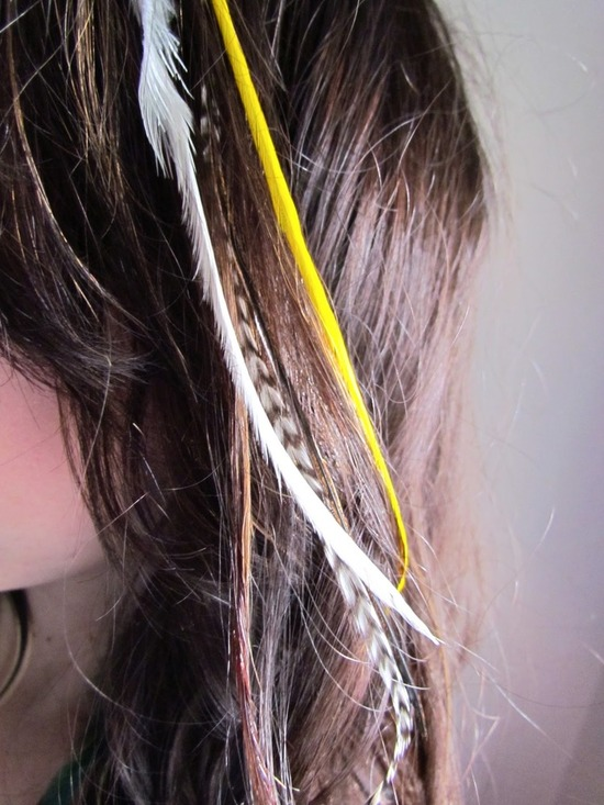 Yellow, black and white feather hair extensions for all-down bridal hairstyle
