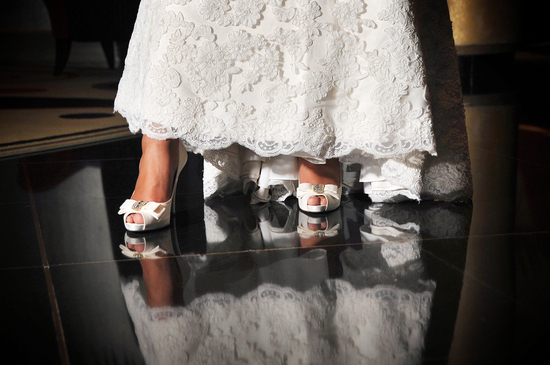 Ivory lace wedding dress and satin peep-toe bridal heels